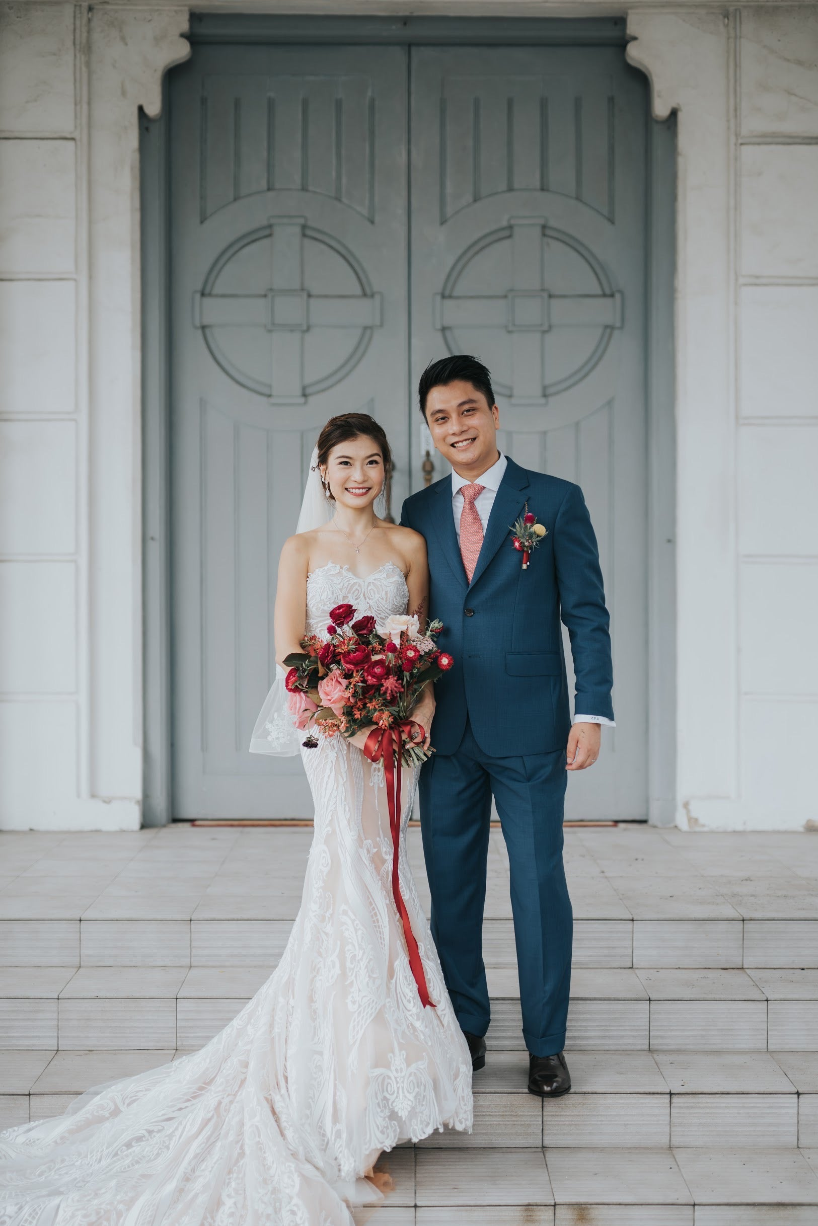 Wedding couple photoshoot on church steps with matching corsage boutonniere and custom bride bouquet Singapore