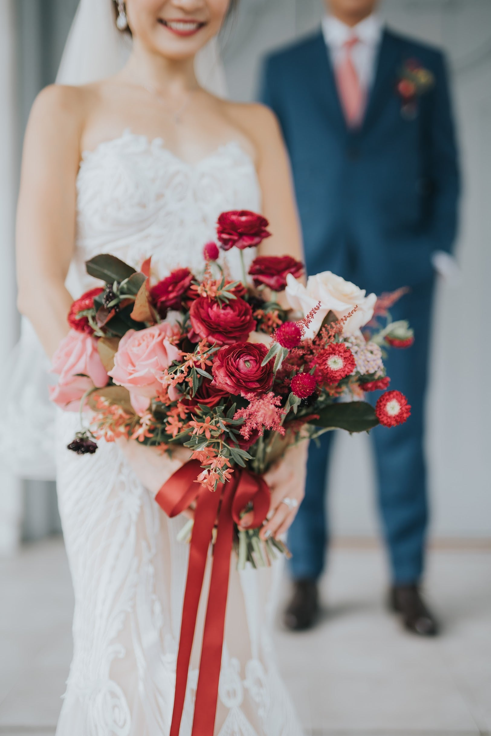 Close up of bride's bouquet of exotic red flowers