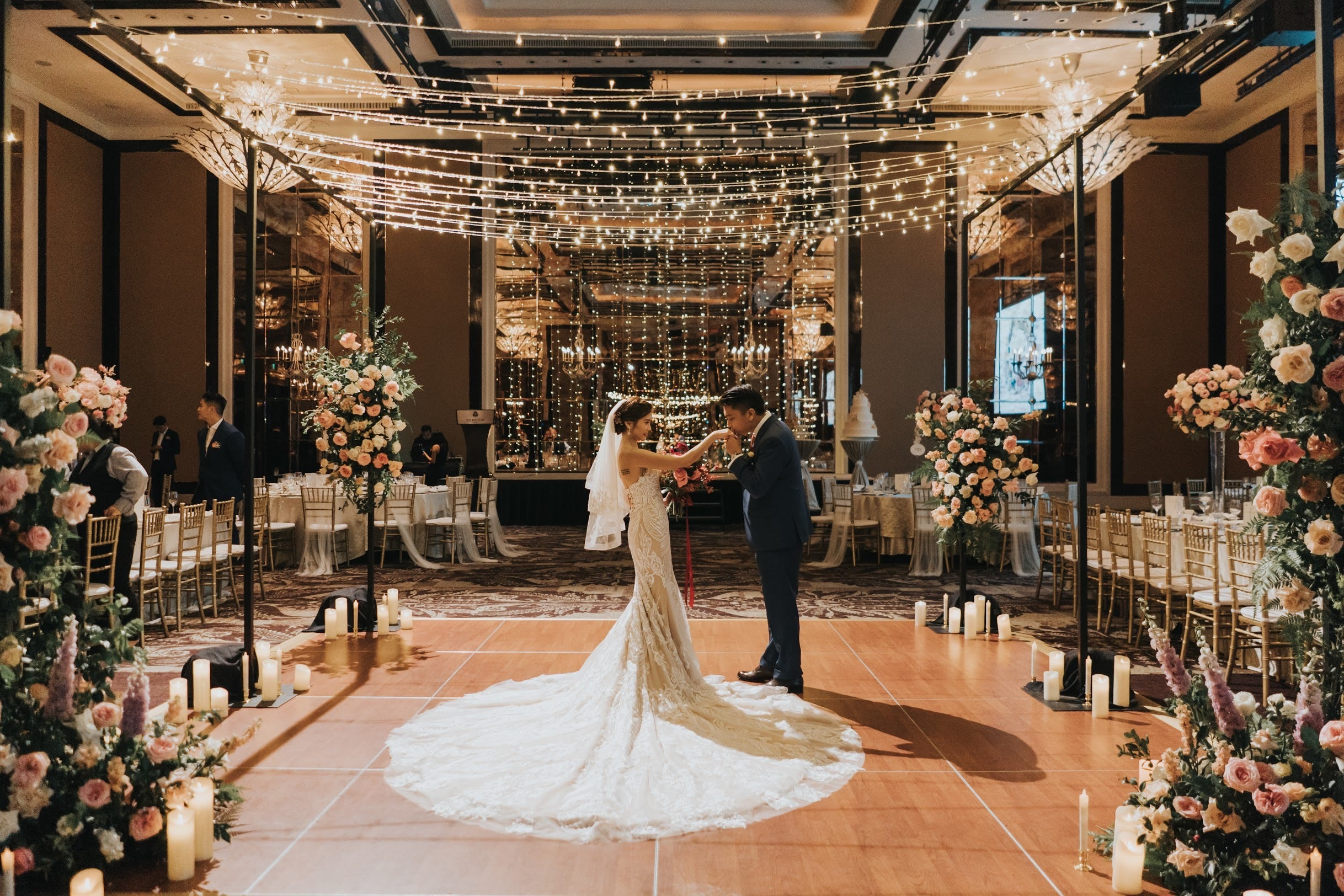 Romantic candles on structured wedding dance floor in St Regis Hotel main ballroom with fairy string lights decoration