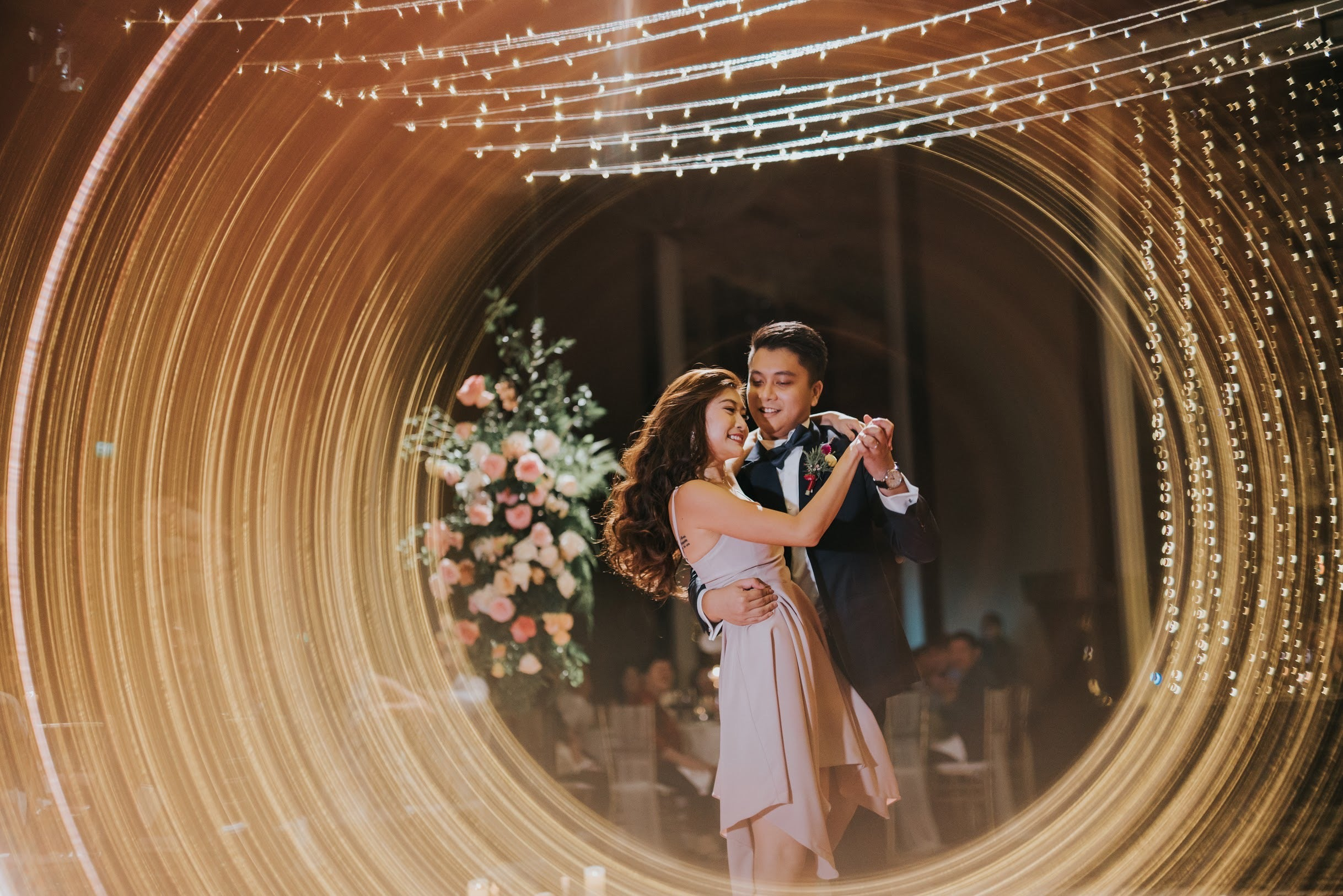Unique light exposure photoshoot for first dance at a wedding hosted at The St. Regis Singapore