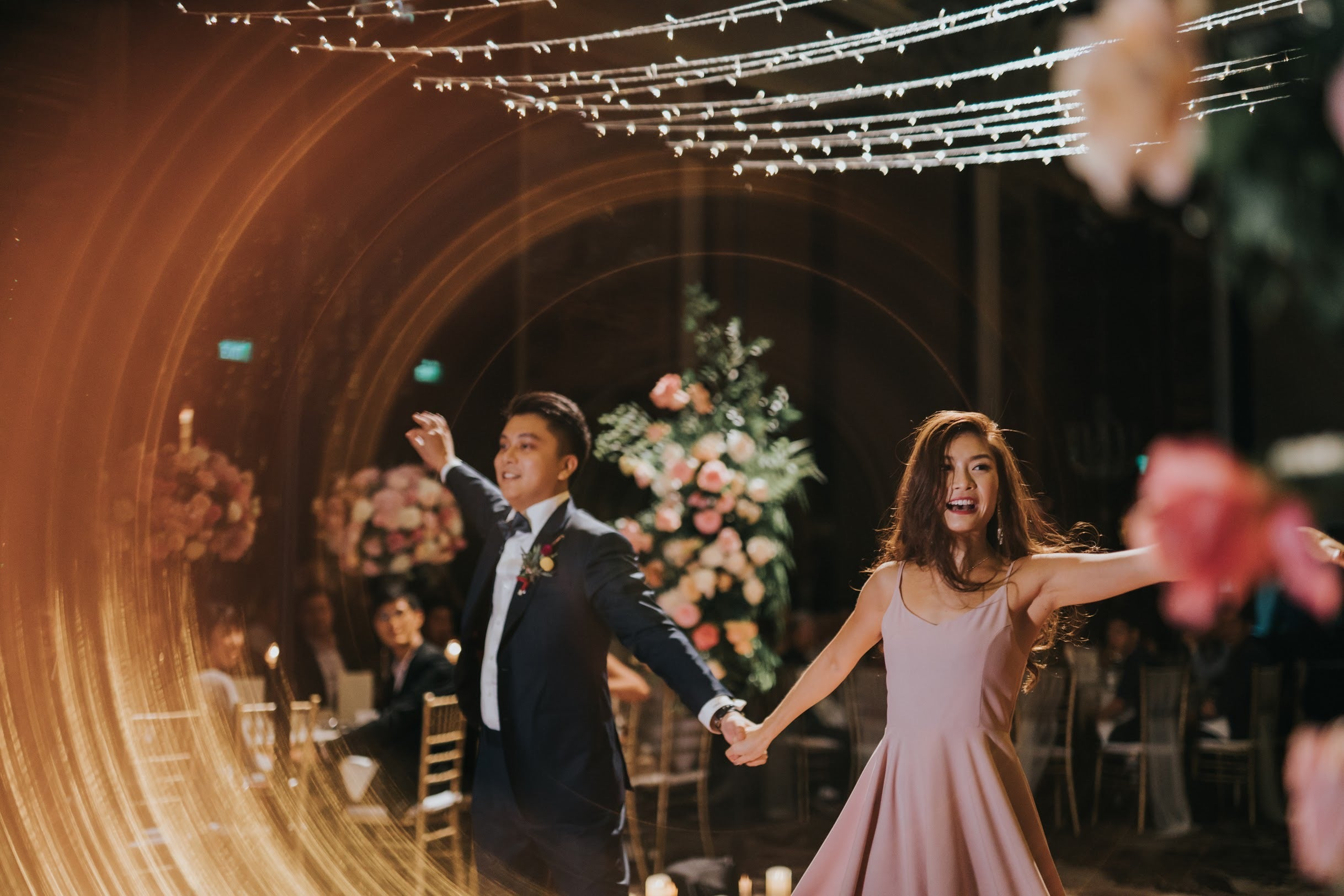 Couple dancing under twinkling string lights in Singapore Orchard hotel St. Regis on Tanglin Road