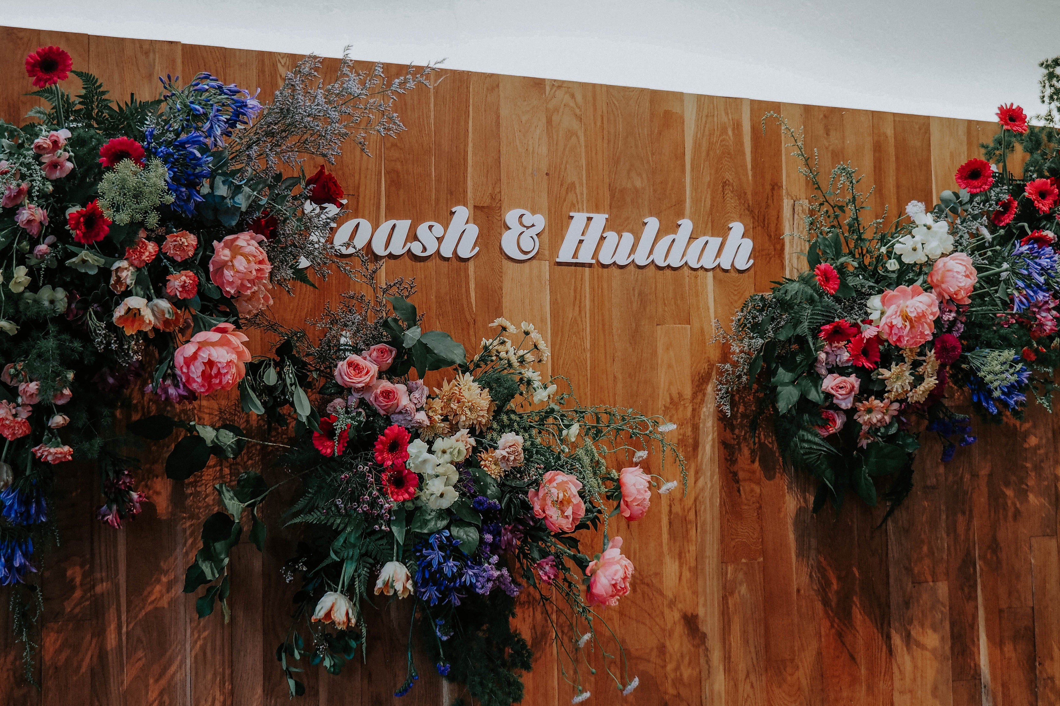 Vintage wooden panels in Singapore wedding venue restaurant at White Rabbit decorated by garden and still life painting inspired blooms