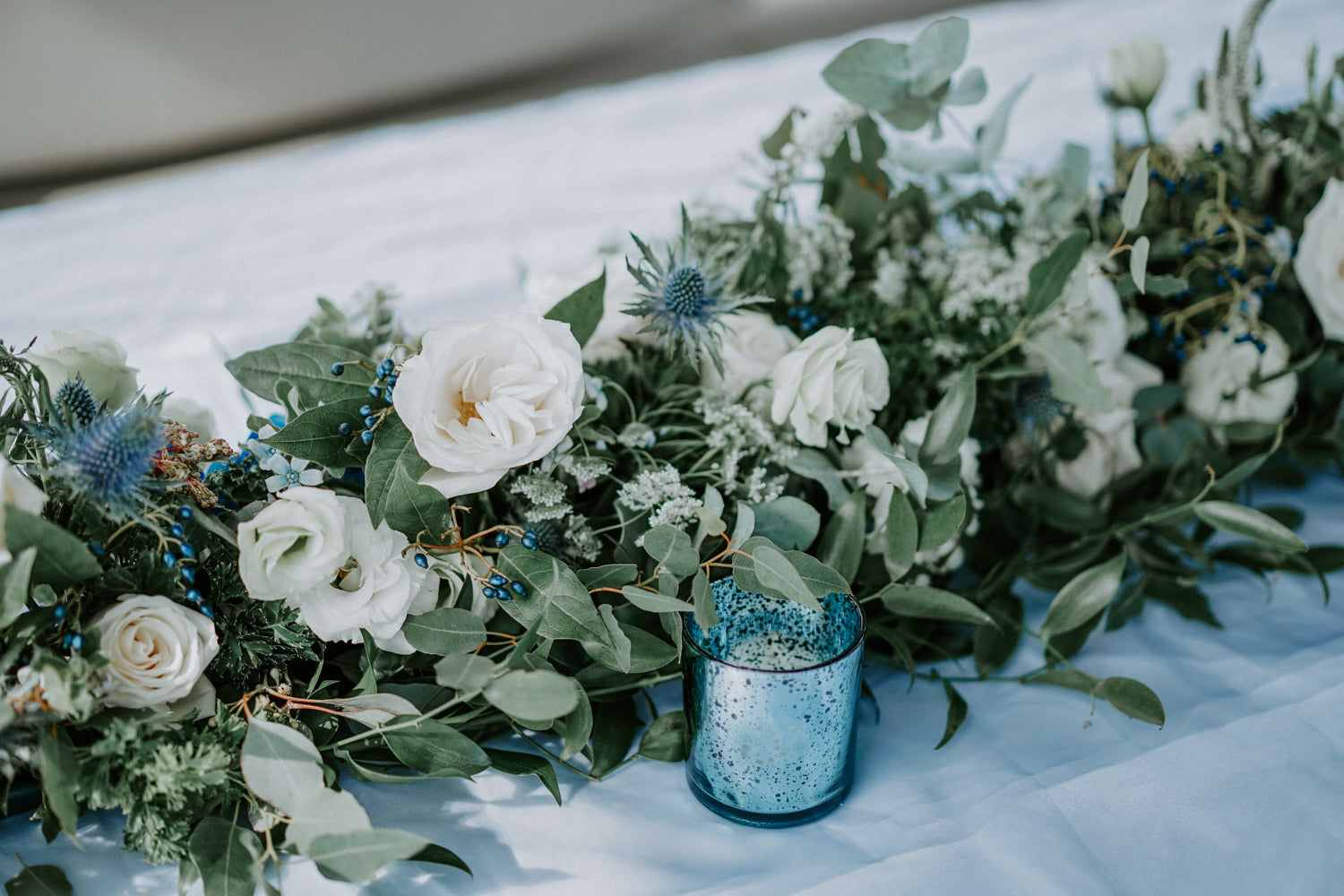 Blue and white flowers table arrangement