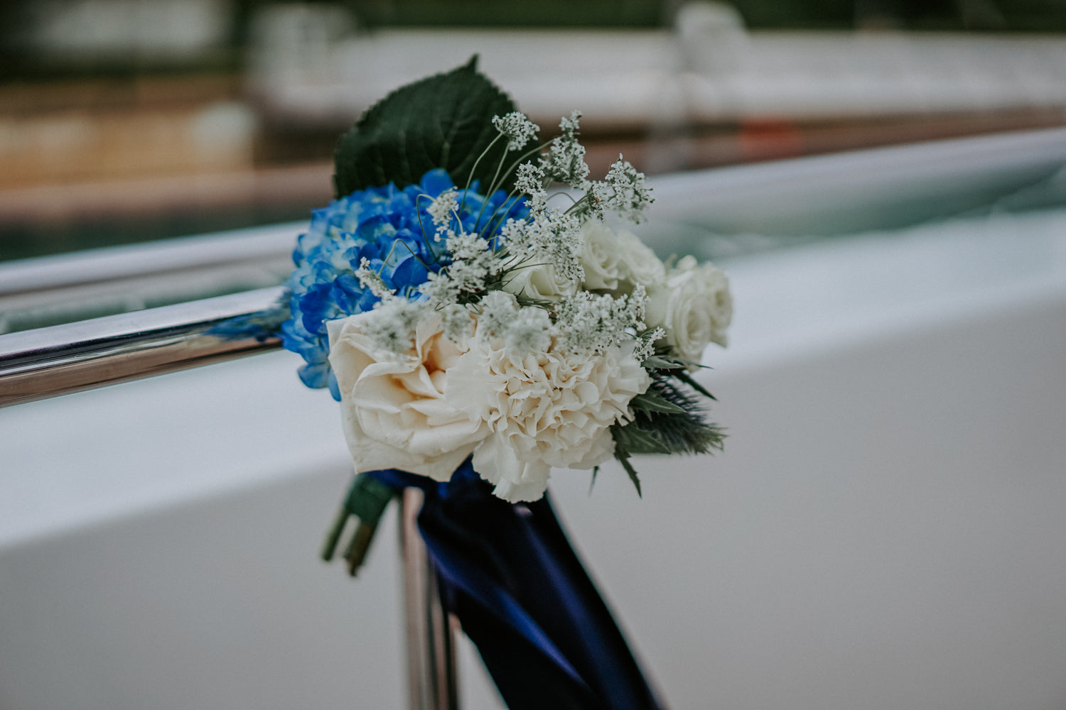 Blue hydrangeas and white roses posy