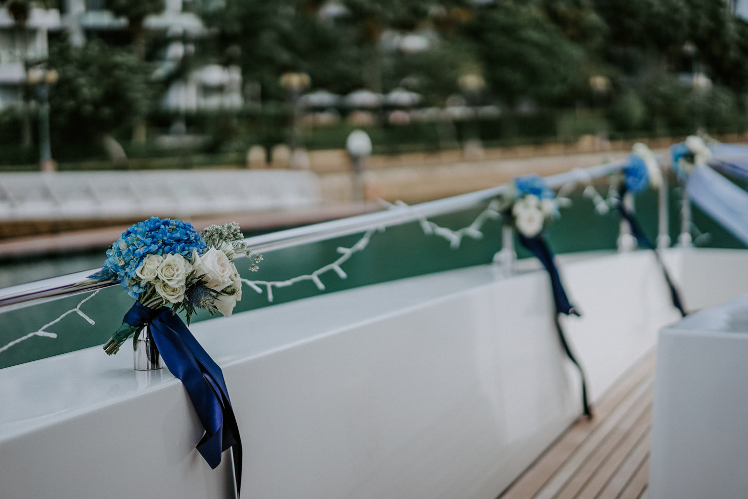 Blue hydrangeas and roses flower posies on yacht
