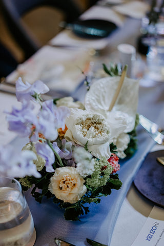 White lotus, calla lily and purple eustoma flower centerpiece