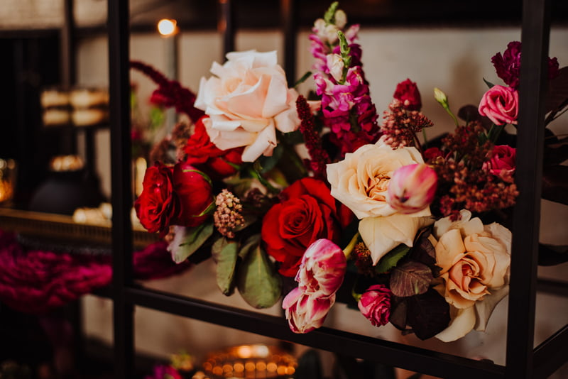 Floral arrangement of tulips and roses set for a dessert bar
