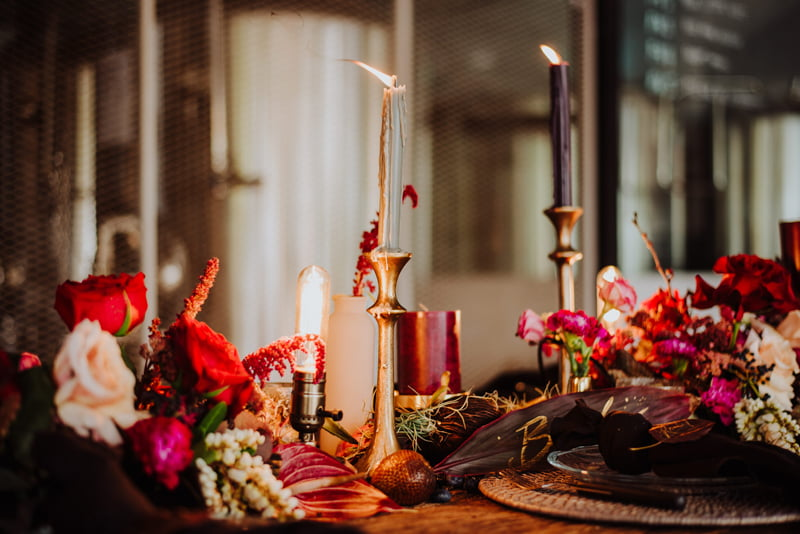 Moody table landscape with lit candles and dusk dark colours set for wedding dinner or wedding lunch at Little Island Brewing Co Changi