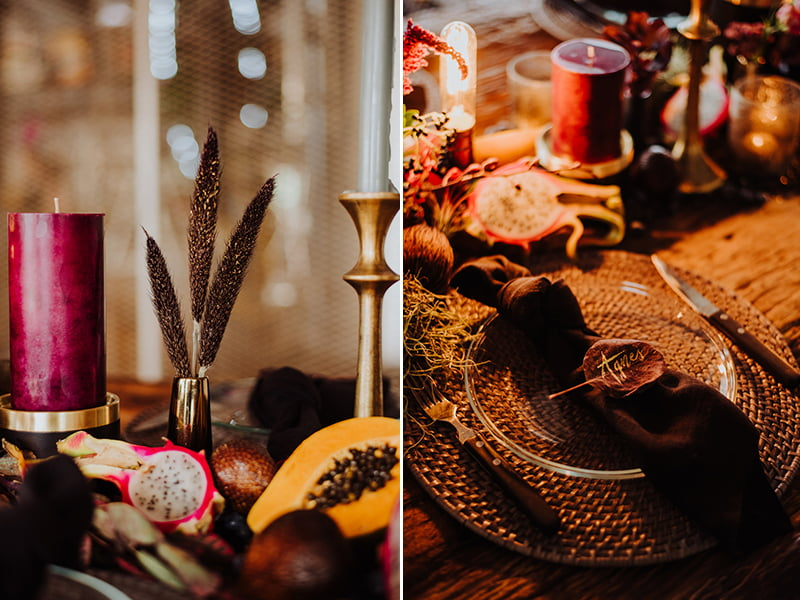 Close up of warm-toned tablescape with purple and burgundy flowers and props