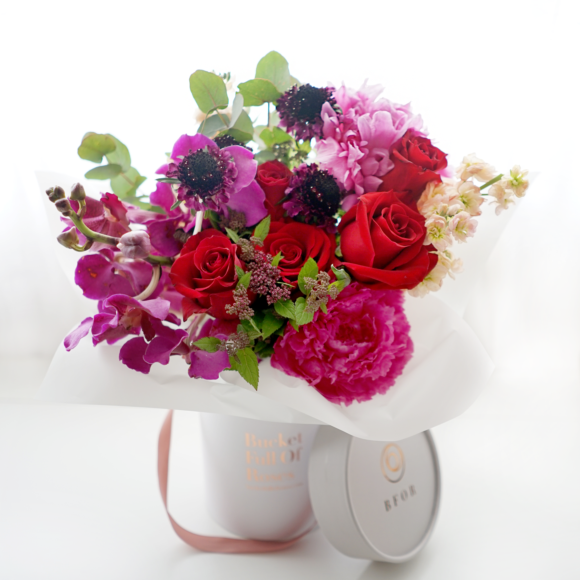 Flower bouquets delivery singapore bucket full of roses jewel tone floral bucket izmirmasajfo