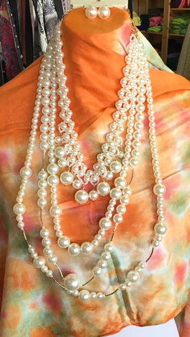 Long Layers of Pearls with Earrings