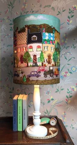 """Sunny Side"" - Happy house street scene lampshade with illuminated window detail."