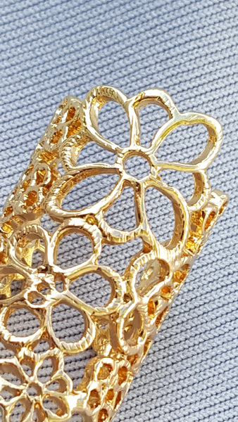 "GOLDEN FLORAL RING.  ""Look, how this ring encompasseth thy finger."" (Richard III 1-2)"