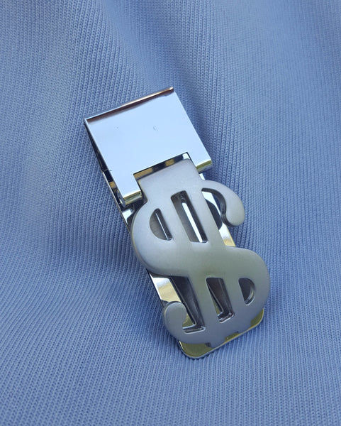 "MONEY CLIP. ""Put money in they purse.""  (Othello  1-3)"