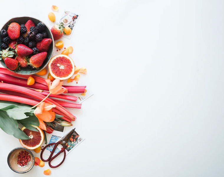 Stack of fresh fruit on a white table