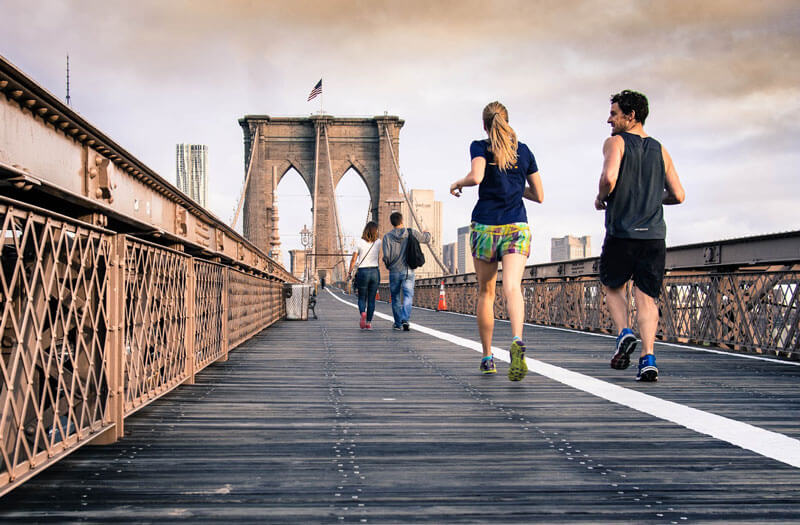 two people running on bridge