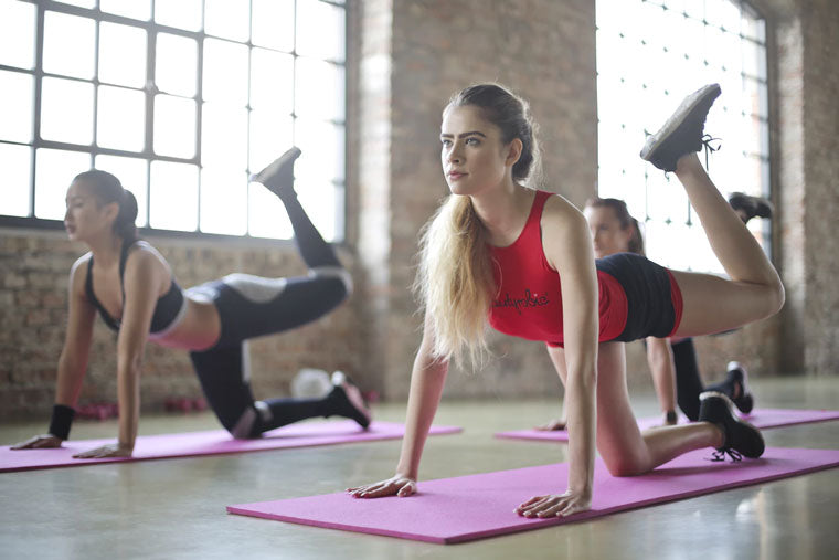 Women do yoga as a keto workout.