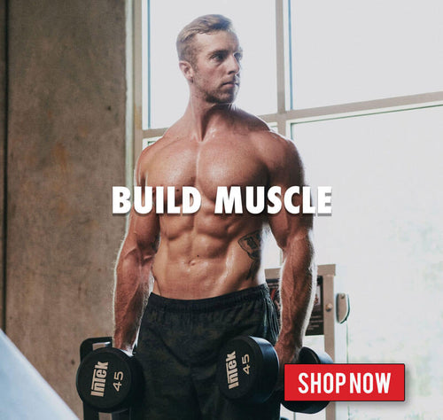 Athletic, shirtless man stands with dumbbells