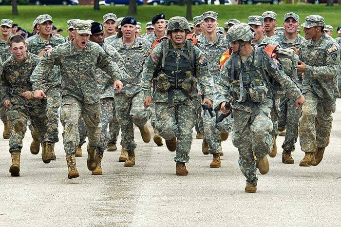 US Soldiers in Uniform Run as a Group