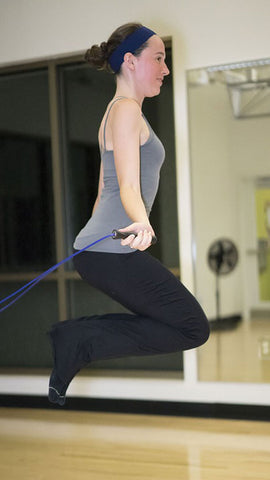 Woman Jumps Rope for Exercise
