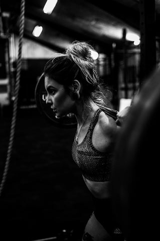 Woman holding a barbell on her shoulders