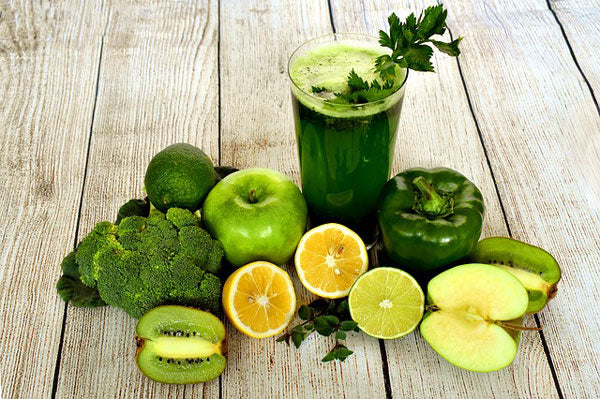 A green smoothie and green vegetables