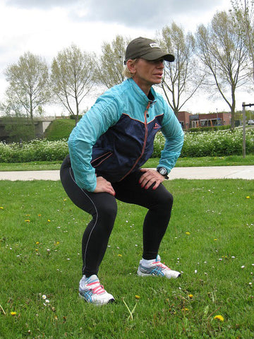 Woman Exercising Does Squats