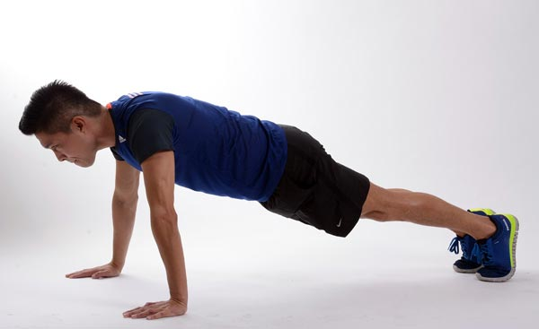 Man Does Plank Workout