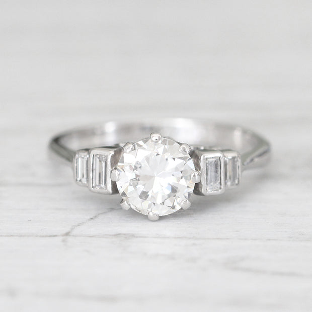 Vintage 1.23 Carat Brilliant Cut Diamond Solitaire with Baguette Diamond Shoulders