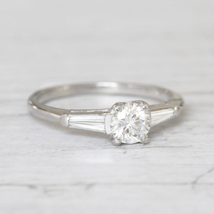 Vintage 0.65 Carat Brilliant Cut and Tapered Baguette Cut Diamond Solitaire