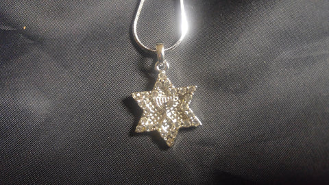 Necklace star of David with tiny Menorah inside