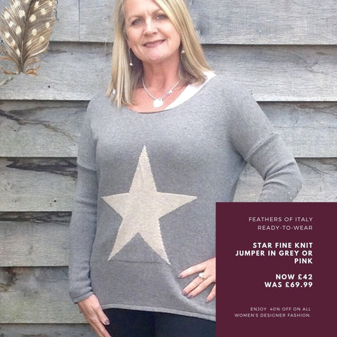 https://www.feathersofitaly.co.uk/products/star-fine-knit-jumper-in-grey-with-silver-heart-made-in-italy-by-feathers-of-italy