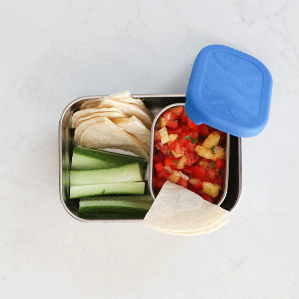 Blue Water Bento with pineapple salsa, tortilla triangles, and celery.