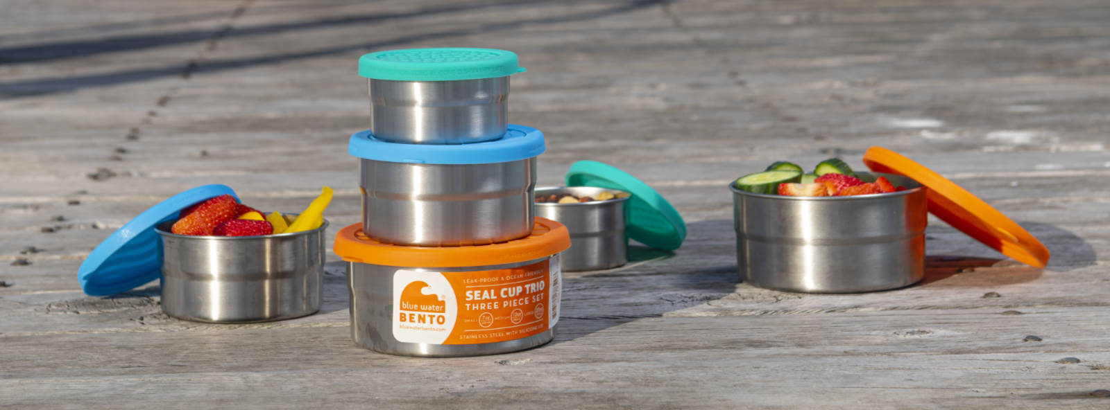 ECOlunchbox Seal Cups and containers on dock near the ocean.