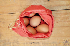 Eggs packed in a zero waste, re-usable cloth bag