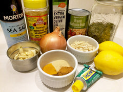 Tali sauce recipe ingredients including salt, garlic, lemon, pumpkin seeds, mustard, onion, blanched almonds, garbanzo beans and spices