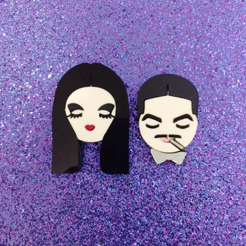 Morticia and Gomez brooch set