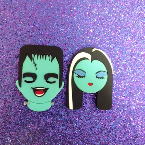 Lily and Herman Munster brooch set