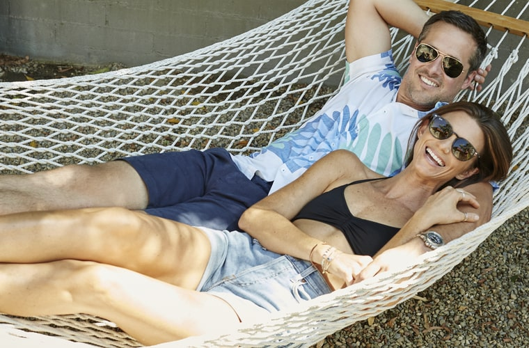 man in hawaiian shirt with woman in hammock