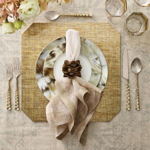 Angkor Placemat Gold in a lifestyle with a matching placesetting
