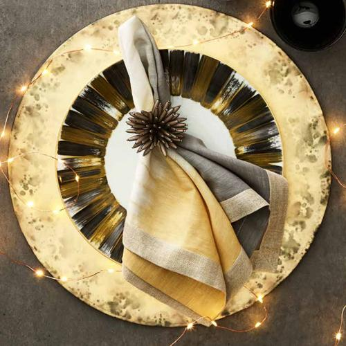 Spoke Taupe Napkin Ring in a lifestyle with other products by Kim Seybert