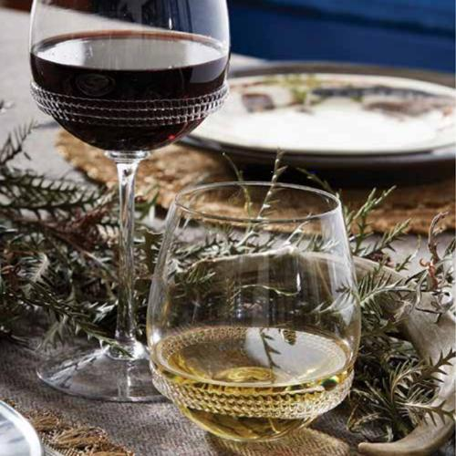 Dean Stemless Wine Glass in a lifestyle image with other products  by Juliska