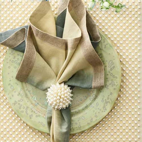 Zinnia Pearl Napkin Ring in a lifestyle with other products by Kim Seybert