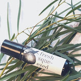 Fresh Squeezed Roll-on Perfume in Lifestyle by Broken Top Candle Co.