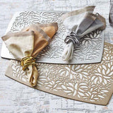 Gold and silver Flux napkin rings with matching placemats and napkins