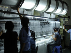 Weaving machine setup in microfiber production change over