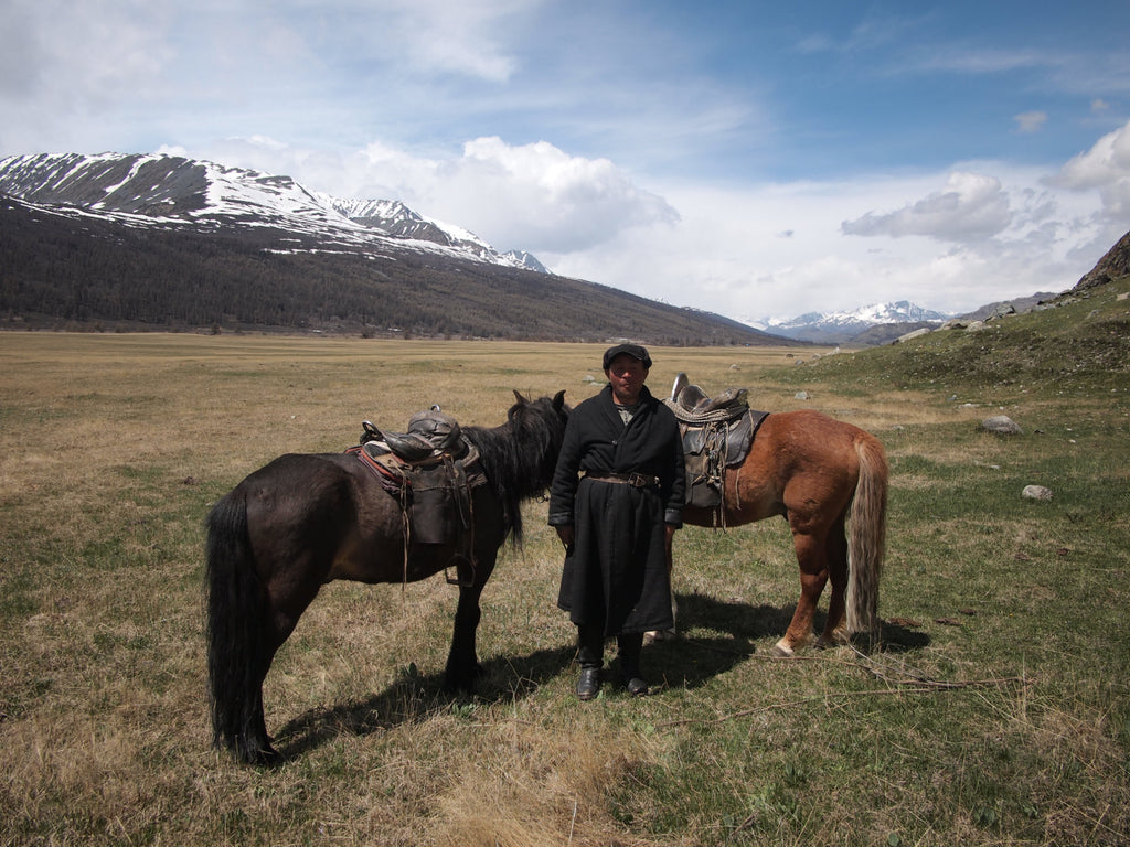 Kazakh nomad with his horses, Altai Tavan Bogd National Park