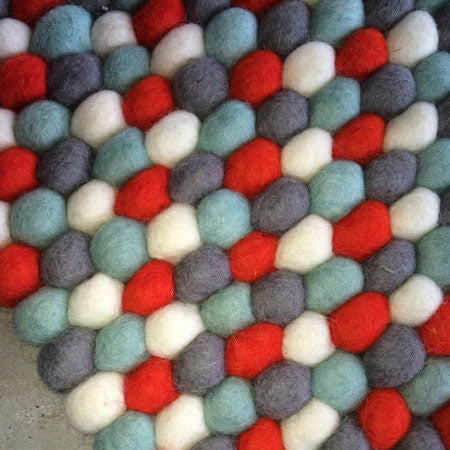 red and grey felt ball rug