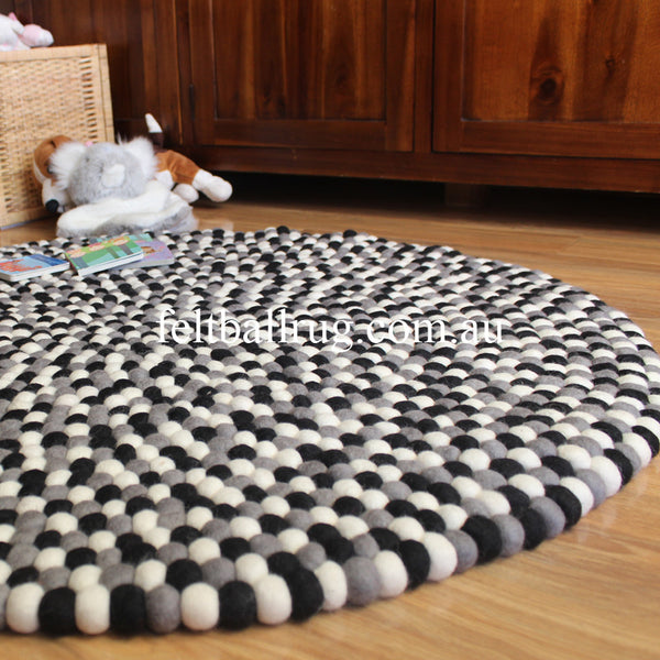 black grey and white felt ball rug