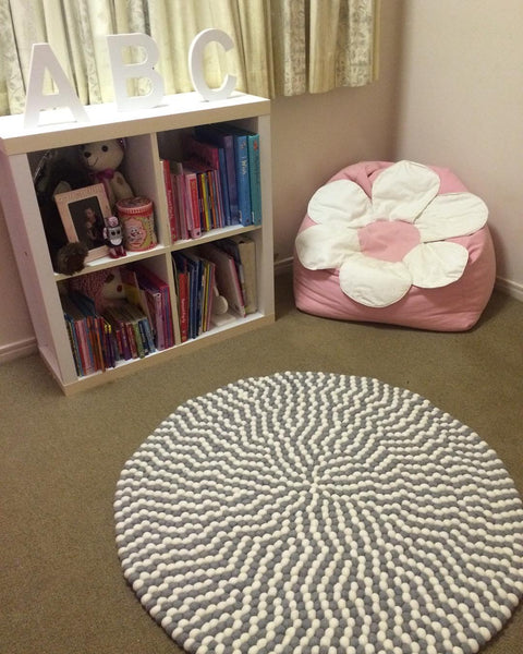 grey and white felt ball rug